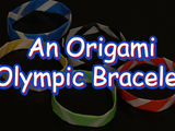 "Get into the spirit of the Winter Olympics by making fun Origami bracelets! You will need: square 5.9"" origami paper (red, blue, black, green, yellow), and tape."