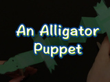 Learn how to make an alligator puppet! You will need: construction paper, 2 popsicle sticks, scissors, markers, and tape.
