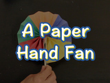 Learn how to make a Paper Hand Fan! You will need: colored construction paper, 2 popsicle sticks, tape, scissors, glue, a ruler, and a pencil/pen.
